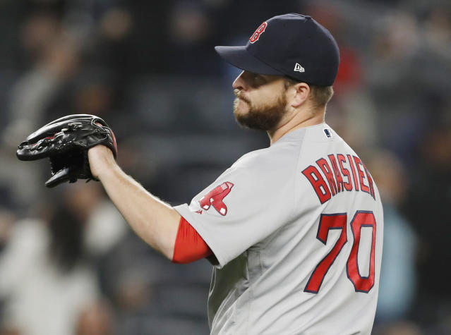 Boston Red Sox relief pitcher Ryan Brasier (70) reacts after allowing a seventh-inning, grand slam to New York Yankees Brett Gardner (11) in a baseball game, Wednesday, April 17, 2019, in New York. (AP Photo/Kathy Willens)