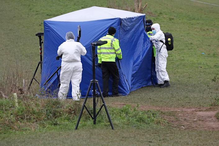 Investigators at a forensic tent in Bugs Bottom field, Emmer Green, where Olly was killed (PA)