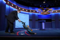 The carpet is vacuumed as final preparations are made ahead of the second and final presidential debate Thursday, Oct. 22, 2020, at Belmont University in Nashville, Tenn. (AP Photo/Patrick Semansky)