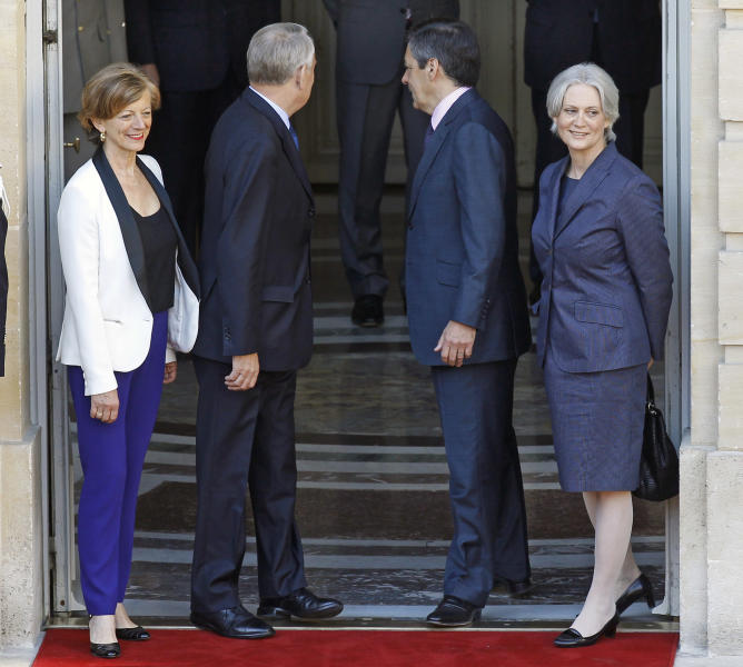 Outgoing French prime minister Francois Fillon and his wife Penelope, right, pose with new prime minister Jean-Marc Ayrault, second from left, and his wife Brigitte, left, at the Hotel Matignon in Paris, Wednesday May 16, 2012. France's new prime minister, a moderate Socialist with an affinity for Germany who will no doubt be quickly pressed into service to tend to the nation's all-important relationship with Berlin, took office Wednesday.(AP Photo/Remy de la Mauviniere)