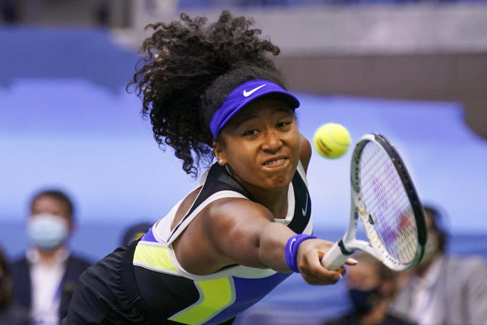 FILE - In this Sept. 12, 2020, file photo, Naomi Osaka, of Japan, returns a shot to Victoria Azarenka, of Belarus, during the women's singles final at the U.S. Open tennis tournament in New York. Osaka has been selected by The Associated Press as the Female Athlete of the Year. (AP Photo/Seth Wenig, File)