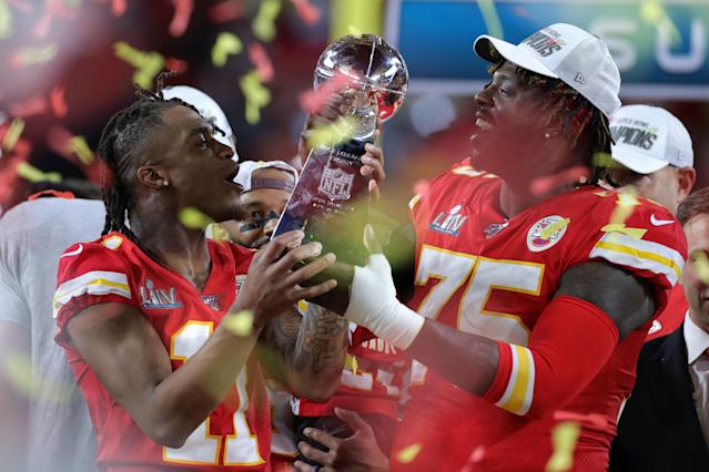 """Demarcus Robinson (11) and Cameron Erving (75) of the <a class=""""link rapid-noclick-resp"""" href=""""/nfl/teams/kansas-city/"""" data-ylk=""""slk:Kansas City Chiefs"""">Kansas City Chiefs</a> celebrate with the Vince Lombardi Trophy. (Photo by Rob Carr/Getty Images)"""