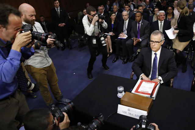 "<p>Photographers surround acting FBI Director Andrew McCabe as he takes his seat with a folder marked ""Secret,"" on Capitol Hill in Washington, May 11, 2017, prior to testifying before the Senate Intelligence Committee hearing on major threats facing the U.S. (Photo: Jacquelyn Martin/AP) </p>"