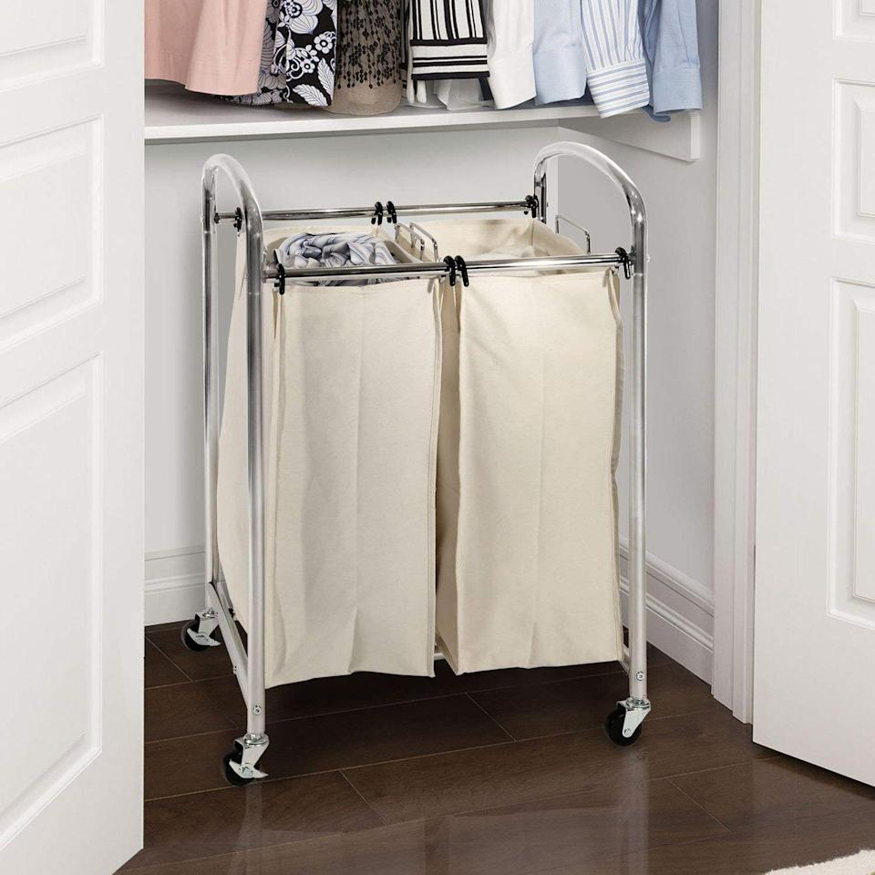 """<p>Have a two-compartment hamper in the bedrooms so everyone can sort lights from darks as they undress.</p><p><strong><a class=""""link rapid-noclick-resp"""" href=""""https://www.amazon.com/Seville-Classics-Mobile-Compact-Laundry/dp/B016Y9GMAW/?tag=syn-yahoo-20&ascsubtag=%5Bartid%7C10070.g.3310%5Bsrc%7Cyahoo-us"""" rel=""""nofollow noopener"""" target=""""_blank"""" data-ylk=""""slk:SHOP HAMPERS"""">SHOP HAMPERS</a></strong></p>"""