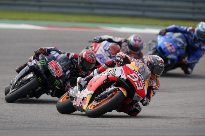 Spain's Marc Marquez (93) steers through a turn ahead of Fabio Quartararo (20), of France, Jorge Martin (89), also of Spain, and Alex Rins (42), of Australia, during the MotoGP Grand Prix of the Americas motorcycle race at Circuit of the Americas, Sunday, Oct. 3, 2021, in Austin, Texas. (AP Photo/Eric Gay)