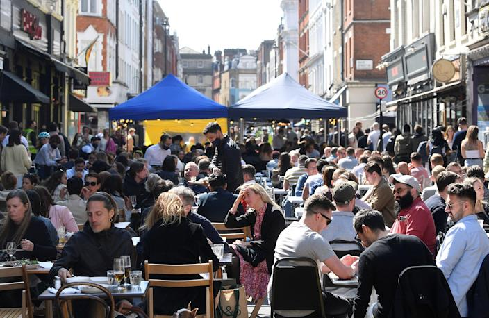 <p>Crowds have returned to popular destinations such as London's Soho after restrictions were eased</p> (REUTERS)