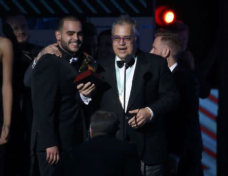 "Producer Gustavo Farias accepts the award for album of the year for ""Los Duo 2"" by Juan Gabriel at the 17th Annual Latin Grammy Awards in Las Vegas, Nevada, U.S., November 17, 2016.  REUTERS/Mario Anzuoni"