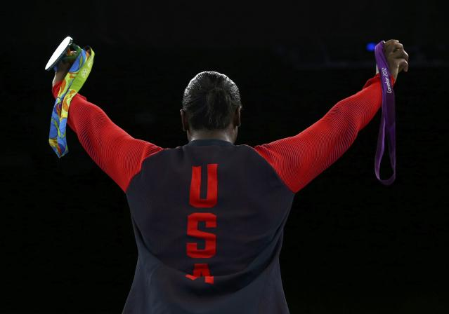2016 Rio Olympics - Boxing - Victory Ceremony - Women's Middle (75kg) Victory Ceremony - Riocentro - Pavilion 6 - Rio de Janeiro, Brazil - 21/08/2016. Gold medallist Claressa Shields (USA) of USA poses with her medals from Rio 2016 and London 2012. REUTERS/Peter Cziborra FOR EDITORIAL USE ONLY. NOT FOR SALE FOR MARKETING OR ADVERTISING CAMPAIGNS.
