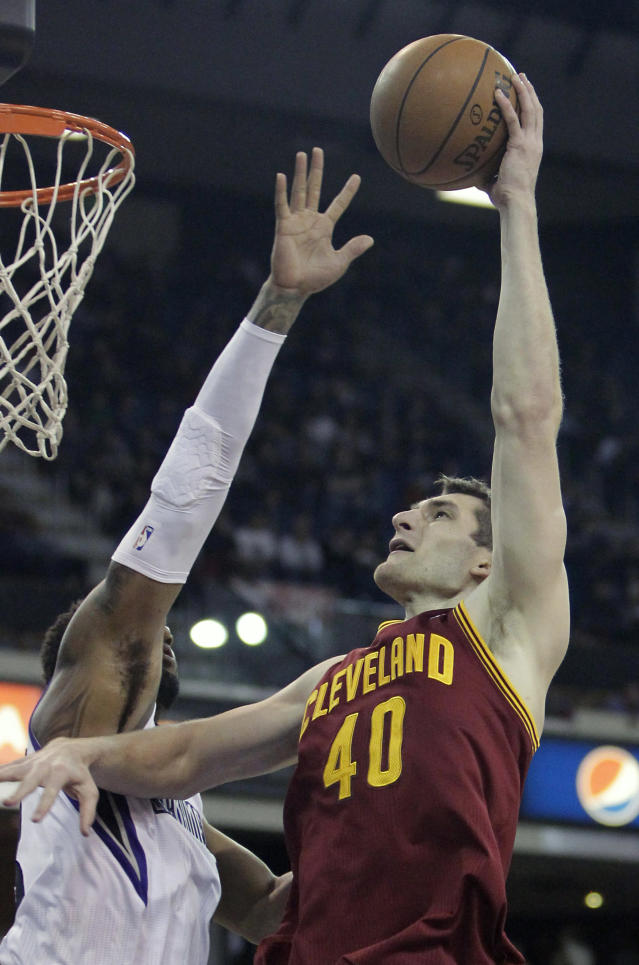 Cleveland Cavaliers center Tyler Zeller, right, shoots over Sacramento Kings forward Derrick Williams during the first quarter of an NBA basketball game in Sacramento, Calif., Sunday, Jan. 12, 2014. (AP Photo/Rich Pedroncelli)