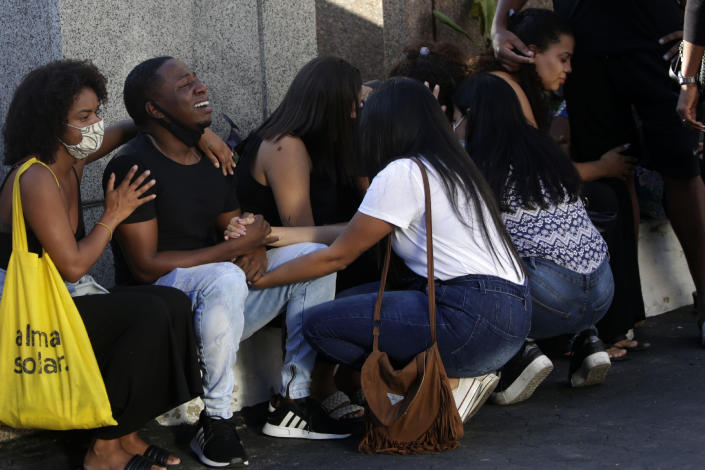 Family and friends grieve during the funeral of Kathlen Romeu, a young pregnant woman killed by a stray bullet, in Rio de Janeiro, Brazil, Wednesday, June 9, 2021. Stray bullets have struck at least six pregnant women in Rio since 2017, but Romeu was the first to die, according to Crossfire, a non-governmental data project that tracks armed violence. (AP Photo/Bruna Prado)