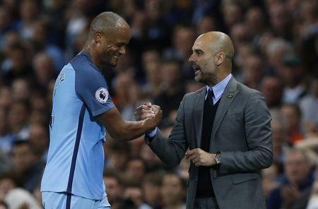 Britain Football Soccer - Manchester City v West Bromwich Albion - Premier League - Etihad Stadium - 16/5/17 Manchester City's Vincent Kompany with Manchester City manager Pep Guardiola after he is substituted Reuters / Andrew Yates Livepic