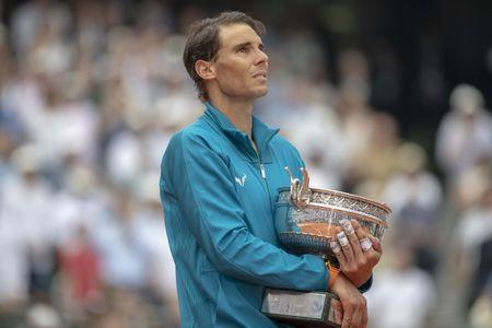 Jun 10, 2018, Paris, France: Rafael Nadal (ESP) poses with the trophy after his men's singles final against Dominic Thiem (AUT) on day 15 of the 2018 French Open at Roland Garros. Mandatory Credit: Susan Mullane-USA TODAY Sports