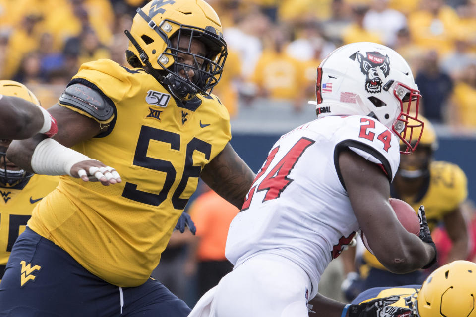 FILE - In this Sept. 14, 2019, file photo, West Virginia defensive lineman Darius Stills (56) moves in on a North Carolina State player during an NCAA college football game in Morgantown, W.Va. Dante Stills and his older brother, Darius, are among the Big 12's sack leaders and they'll be looking to cause more disruption when West Virginia hosts No. 11 Texas on Saturday. They are the sons of former all-Big East and NFL Pro Bowl linebacker Gary Stills. (AP Photo/Raymond Thompson, File)