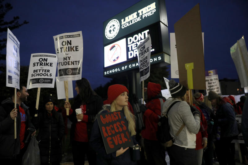 Striking teachers and supporters walk a picket line outside Lane Tech High School in Chicago, on the first day of a strike by the Chicago Teachers Union, Thursday, Oct. 17, 2019. (Jose M. Osorio/Chicago Tribune via AP)