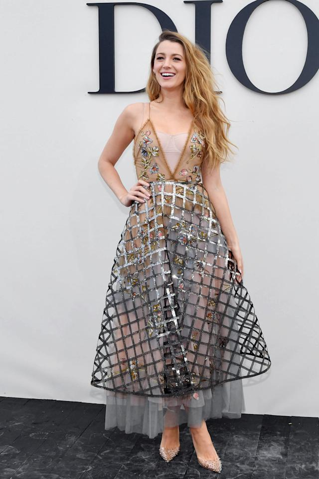 """<p><a href=""""https://www.popsugar.com/fashion/Blake-Lively-Dior-Dress-Paris-Fashion-Week-2018-45325004"""" class=""""ga-track"""" data-ga-category=""""Related"""" data-ga-label=""""https://www.popsugar.com/fashion/Blake-Lively-Dior-Dress-Paris-Fashion-Week-2018-45325004"""" data-ga-action=""""In-Line Links"""">Blake attended the Christian Dior Spring 2019 show</a> during Paris Fashion Week in this caged midi dress.</p>"""