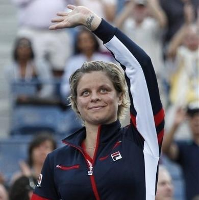 Kim Clijsters of Belgium waves to the crowd after she lost to Laura Robson of Great Britain in the second round of play at the 2012 US Open tennis tournament,  Wednesday, Aug. 29, 2012, in New York. (AP Photo/Mel C. Evans)