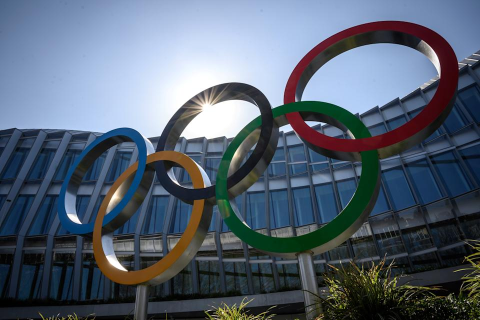"The Olympic Rings logo is pictured in front of the headquarters of the International Olympic Committee (IOC) in Lausanne on March 18, 2020, as doubts increase over whether Tokyo can safely host the summer Games amid the spread of the COVID-19. - Olympic chiefs acknowledged on March 18, 2020 there was no ""ideal"" solution to staging the Tokyo Olympics amid a backlash from athletes as the deadly coronavirus pandemic swept the globe. The Tokyo Olympics are scheduled to run between July 24 and August 9, 2020. (Photo by Fabrice COFFRINI / AFP) (Photo by FABRICE COFFRINI/AFP via Getty Images)"