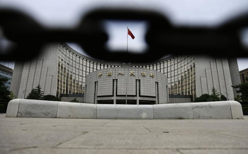 The headquarters of the People's Bank of China is pictured behind an iron chain in Beijing