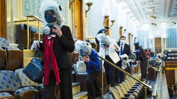 PHOTO: People shelter in the House gallery as protesters try to break into the House Chamber at the Capitol, Jan. 6, 2021. (Andrew Harnik/AP)
