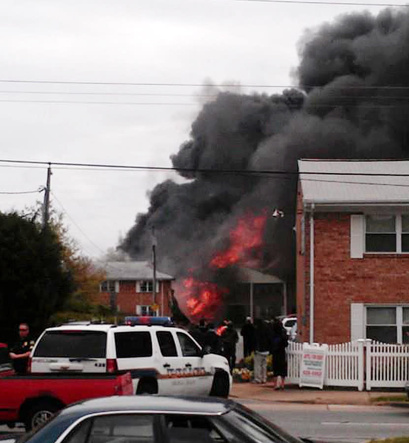 In this image made from video and provided by WVEC TV, smoke billows near an apartment complex where a Navy jet crashed in Virginia Beach, Va., Friday, March 6, 2012. The F/A-18 Hornet crashed into the apartment building, officials said, and the two-member crew ejected safely. There were no immediate reports of injuries on the ground. (AP Photo/ WVEC-TV)
