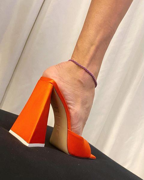 "<p>One of the best parts of having a pair of sky-high heels on hand is their undeniable ability to have a leg-lengthening effect and create a streamlined silhouette. It's one of the reasons why brands like The Attico and Nodaleto have gravitated toward the design for summer 2021. Pro tip: Opt for a style in a candy-colored shade to fully commit to the trend. </p><p><a href=""https://www.instagram.com/p/CIVegw3AnmK/?igshid=3aksoghy43im"" rel=""nofollow noopener"" target=""_blank"" data-ylk=""slk:See the original post on Instagram"" class=""link rapid-noclick-resp"">See the original post on Instagram</a></p>"