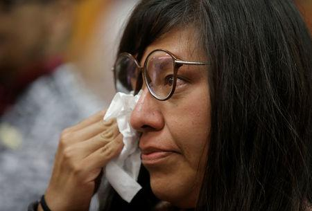 Norma Jimenez dries her tears after her hearing was convened by the judges of the Inter-American Court of Human Rights in San Jose