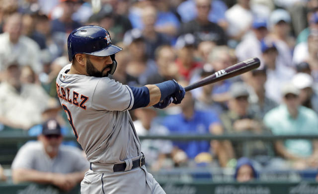 Houston Astros' Marwin Gonzalez hits a home run against the Seattle Mariners during the fourth inning of a baseball game Wednesday, Aug. 1, 2018, in Seattle. (AP Photo/Elaine Thompson)