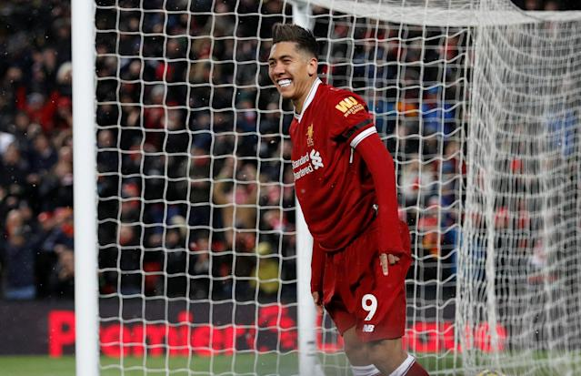 "Soccer Football - Premier League - Liverpool vs Watford - Anfield, Liverpool, Britain - March 17, 2018 Liverpool's Roberto Firmino celebrates scoring their third goal REUTERS/Phil Noble EDITORIAL USE ONLY. No use with unauthorized audio, video, data, fixture lists, club/league logos or ""live"" services. Online in-match use limited to 75 images, no video emulation. No use in betting, games or single club/league/player publications. Please contact your account representative for further details."