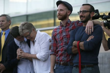 (L to R) Plaintiffs Kody Partridge and her wife Laurie Wood, Derek Kitchen and his partner Moudi Sbeity attend a same-sex marriage rally in Salt Lake City, Utah, October 6, 2014. REUTERS/Jim Urquhart