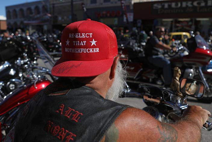 A man wears a hat signed by Ted Nugent as he joins thousands of bikers during the 80th Sturgis Motorcycle Rally in Sturgis, South Dakota, Aug. 10, 2020.