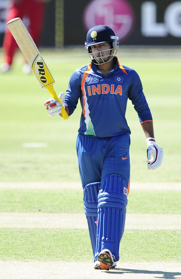 TOWNSVILLE, AUSTRALIA - AUGUST 14: Unmukt Chand of India celebrates scoring a half century during the ICC U19 Cricket World Cup 2012 match between India and Zimbabwe at Tony Ireland Stadium on August 14, 2012 in Townsville, Australia. (Photo by Ian Hitchcock-ICC/Getty Images)