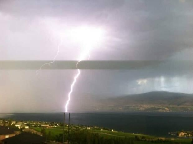 Lightning strikes Okanagan Lake as seen from West Kelowna, B.C., in 2019. (Submitted by Alex Tilley - image credit)