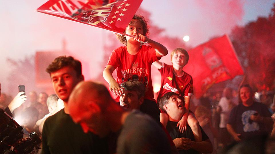 Liverpool fans, pictured here celebrating at Anfield after their Premier League title.