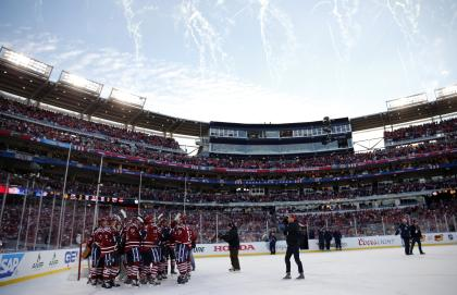 The Capitals celebrate after beating the Blackhawks in the 2015 Winter Classic at Nationals Park. (USA Today)