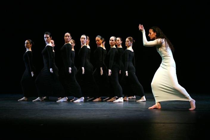 """Elizabeth Auclair, right, performs """"Heretic"""" with members of the Martha Graham ensemble during the final dress rehearsal of Martha Graham Dance Company 80th Anniversary gala at the Skirball Center for the Performing Arts, Tuesday, April 18, 2006 in New York. (AP Photo/Mary Altaffer)"""