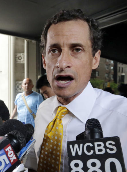 New York City mayoral candidate Anthony Weiner speaks to reporters as he leaves his apartment building in New York on Wednesday, July 24, 2013. The former congressman acknowledged sending explicit text messages to a woman as recently as last summer, more than a year after sexting revelations destroyed his congressional career. (AP Photo/Richard Drew)