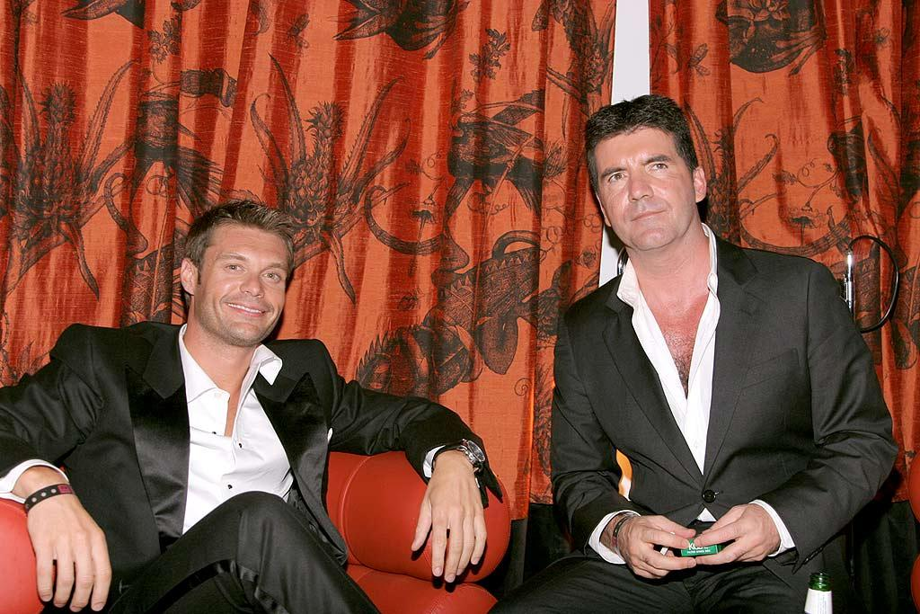 """American Idol's"" Ryan Seacrest and Simon Cowell can deny it all they want when the cameras are rolling, but the business partners happen to be good friends who are often seen dining together at L.A. hot spots such as the Ivy. Kevin Parry/<a href=""http://www.wireimage.com"" target=""new"">WireImage.com</a> - August 27, 2006"