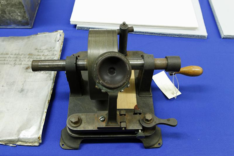 FILE - In this Dec. 13, 2011 file photo, Alexander Graham Bell's Graphaphone 1881 is displayed during a news conference at Smithsonian's National Museum of American History in Washington. The Library of Congress is announcing a plan for saving the nation's history in recorded sound under a mandate from Congress. The library already saves key audio selections each year, but many other recordings are being lost due to a lack of storage capacity, changing technology and disparate copyright laws. Researchers say more than half of the oldest recordings, including audio from George Gershwin, Frank Sinatra and Judy Garland have already been lost.  (AP Photo/Jose Luis Magana, File)