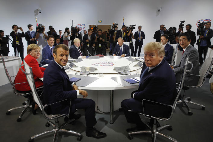 """FILE - In this Aug. 25, 2019 file photo, French President Emmanuel Macron, center left, U.S. President Donald Trump, center right, Japan's Prime Minister Shinzo Abe, right, Britain's Prime Minister Boris Johnson, fourth left, German Chancellor Angela Merkel, left, Canada's Prime Minister Justin Trudeau, second left, Italy's Prime Minister Giuseppe Conte, second right, and European Council President Donald Tusk attend session on """"International Economy and Trade, and International Security Agenda"""" during the G-7 summit in Biarritz, southwestern France. For most of America's allies, Biden is a relief. Trump often sowed chaos, accusing the NATO military alliance of leeching off the United States, insulting the European Union and storming out of a G-7 summit in Canada in 2018. (Philippe Wojazer/Pool Photo via AP, File)"""