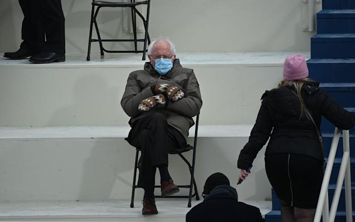 Former presidential candidate, Senator Bernie Sanders (D-Vermont) sits in the bleachers on Capitol Hill before Joe Biden is sworn in as the 46th US President on January 20, 2021, at the US Capitol in Washington, DC - GETTY IMAGES
