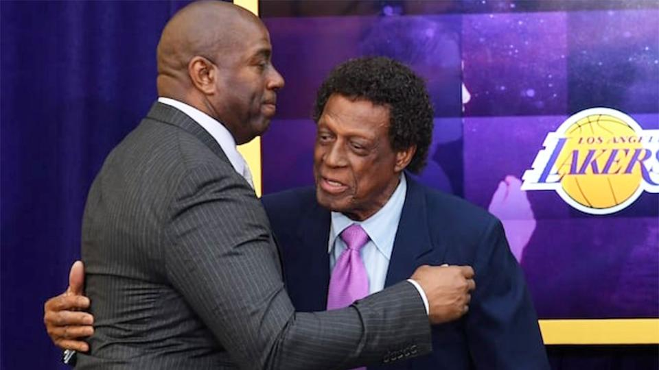 Pictured here, Los Angeles Lakers greats Magic Johnson and Elgin Baylor share a hug.