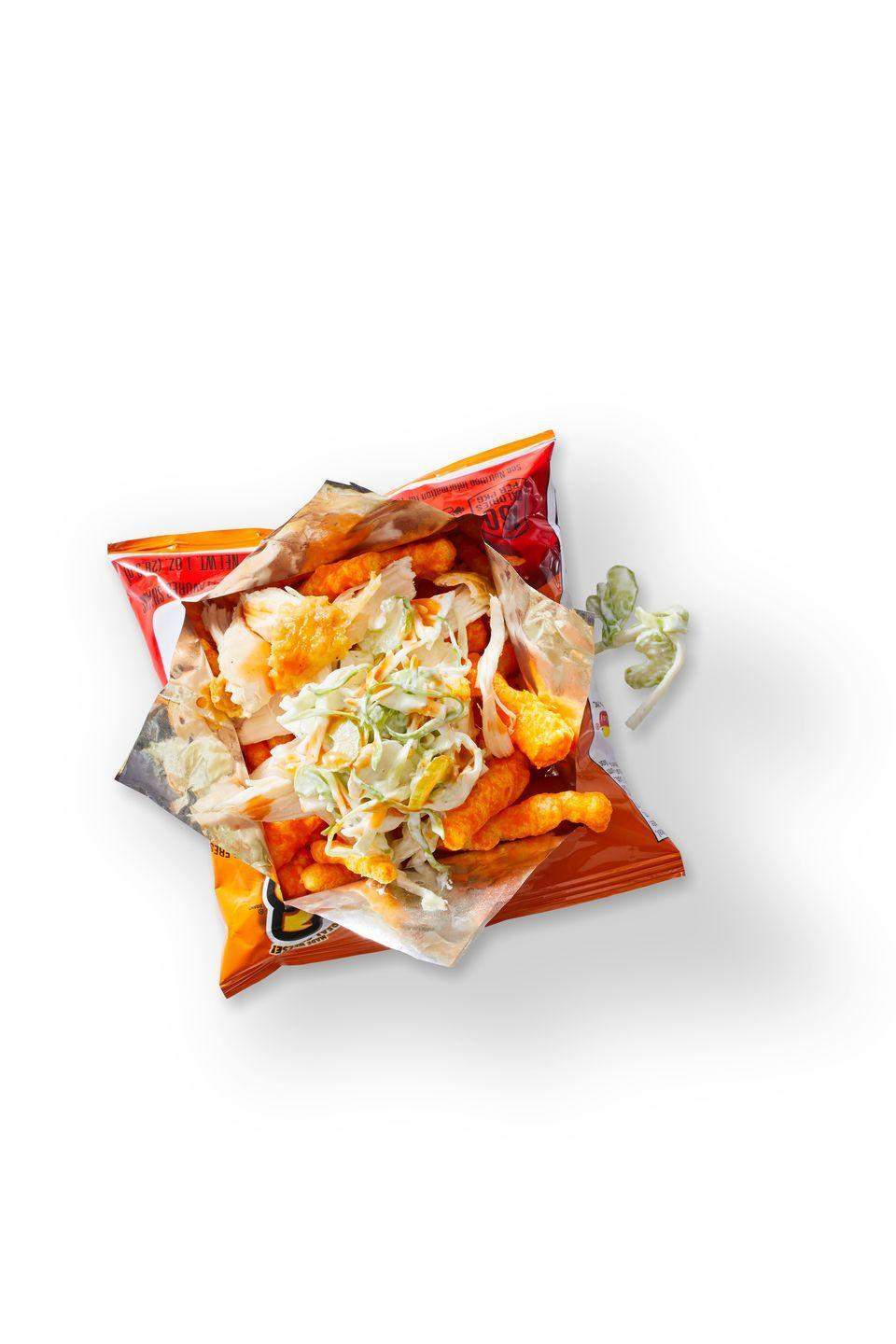 """<p>Turn a bag of Cheetos into a buff-chick snack with shredded chicken, hot sauce, and blue cheese. You'll want more than one.</p><p><em><a href=""""https://www.goodhousekeeping.com/food-recipes/a35182676/red-hot-and-blue-chicken-snack-bag-recipe/"""" rel=""""nofollow noopener"""" target=""""_blank"""" data-ylk=""""slk:Get the recipe for Red Hot and Blue Chicken Snack Bag »"""" class=""""link rapid-noclick-resp"""">Get the recipe for Red Hot and Blue Chicken Snack Bag »</a></em></p>"""
