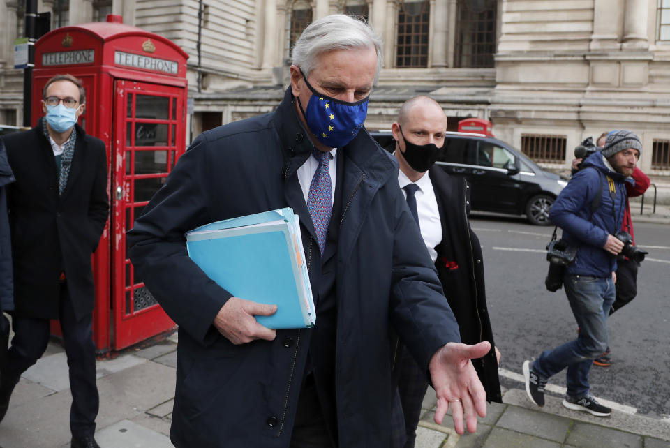 European Commission's Head of Task Force for Relations with the United Kingdom Michel Barnier walks from his hotel to the Conference Centre in London, Wednesday, Nov. 11, 2020. With less than two months to go before the U.K. exits the EU's economic orbit, trade deal talks resume in London. (AP Photo/Frank Augstein)