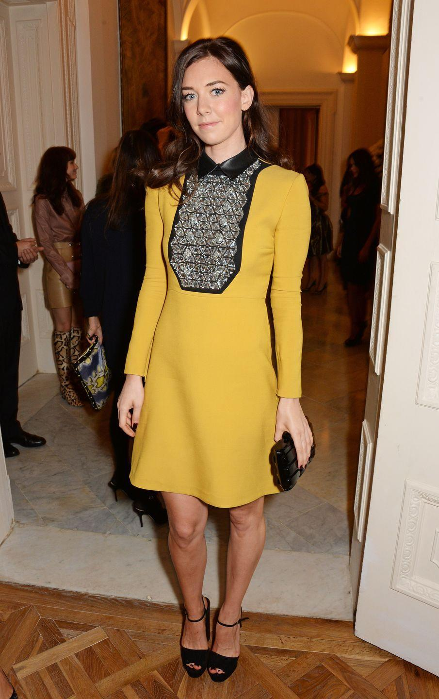 <p>At a private reception hosted by Gucci & Frieze Masters, the actress poses in a yellow silk Gucci dress with leather and crystal embroidery bib detail.</p>