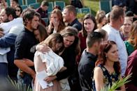 Relatives embrace during the service of Dawna Ray Langford, 43, and her sons Trevor and Rogan, who were killed by unknown assailants, before they are buried at the cemetery in La Mora