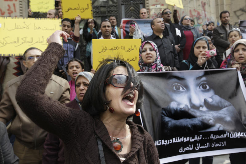 FILE - In this Friday, March 16, 2012, file photo, an Egyptian activist shouts anti-military Supreme Council slogans during a demonstration in front of Cairo's high court, Egypt.  The prosecution of a 15-year-old girl who killed a bus driver after he allegedly tried to rape her in July 2019  has reignited debate over the treatment of women in Egypt's legal system, including blaming female victims of sexual violence and the practice of administering virginity tests.(AP Photo/Amr Nabil)