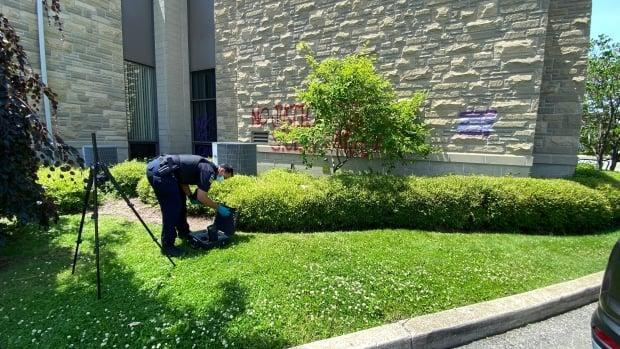 Officers are investigating graffiti spray-painted on Merciful Redeemer Parish in Mississauga as a possible hate crime.  (Paul Smith/CBC - image credit)