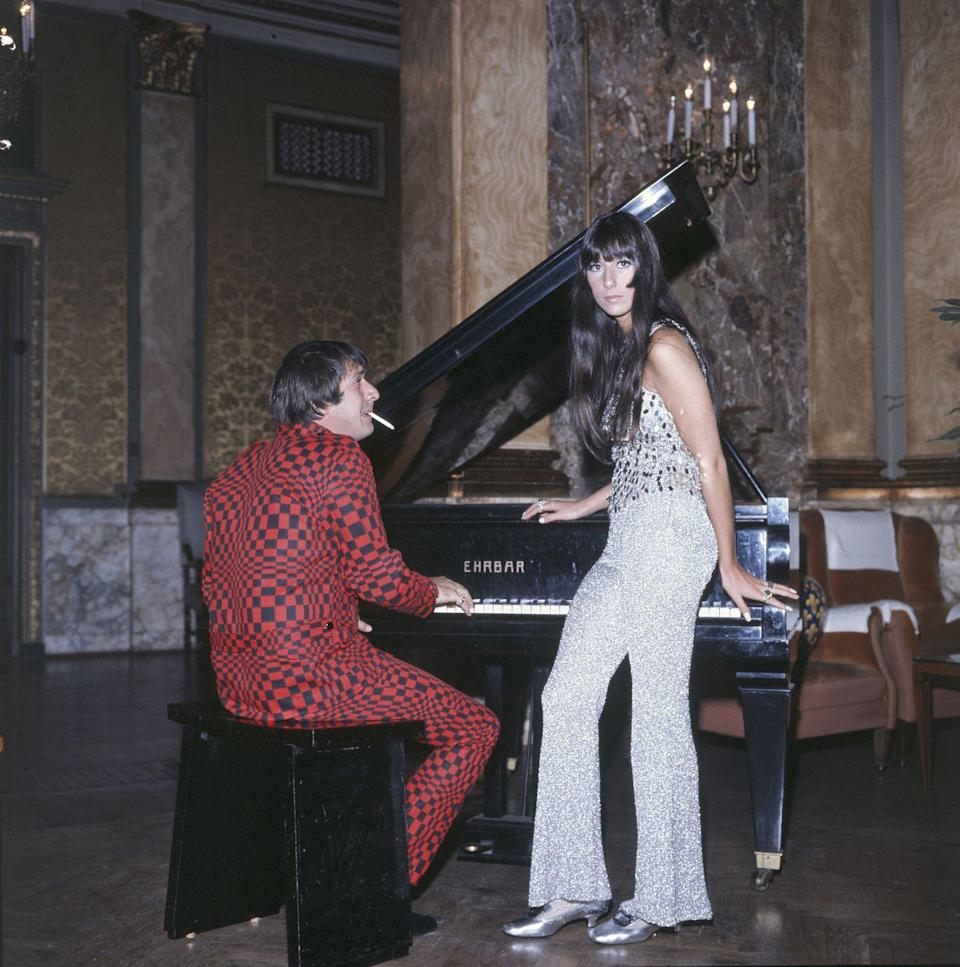 <p>Wearing sparkling metallic pants and a matching sequin top for a performance in Italy with Sonny Bono. </p>