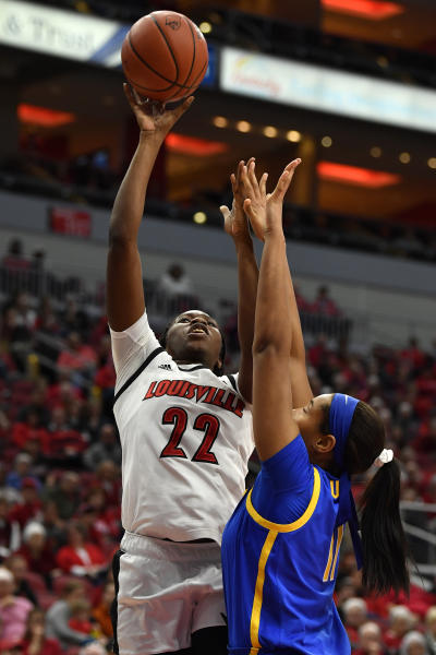 Louisville forward Elizabeth Dixon (22) shoots over Pittsburgh center Cara Judkins (11) during the second half of an NCAA college basketball game in Louisville, Ky., Sunday, Jan. 26, 2020. (AP Photo/Timothy D. Easley)