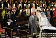 <p>Prince Harry, Duke of Sussex, looks at his bride, Meghan Markle, as she arrives at the altar accompanied by his father, Prince Charles. (Photo: Jonathan Brady/AFP/Getty Images) </p>